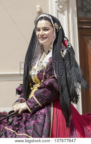 CAGLIARI, ITALY - May 1, 2014: 358 ^ Religious Procession of Sant'Efisio - Sardinia - portrait of a beautiful smiling woman in Sardinian costumes