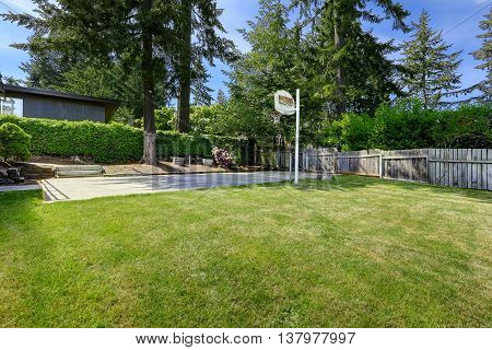 Basketball Court With Concrete Floor And Wooden Fence