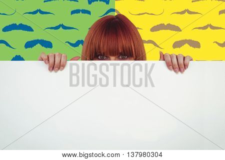 Hipster woman behind a big white card against composite image of mustaches