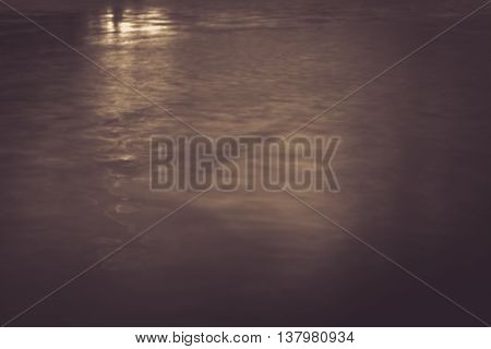 Background of fuzzy water in retro style sepia colour.