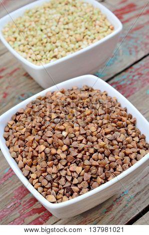 Buckwheat groats in bowl on rustic table