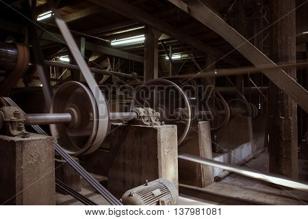 old machine working by water steam engine in agricultural factory