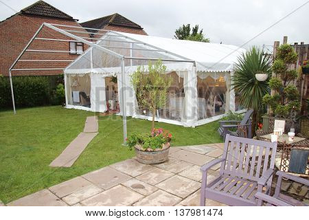 29TH JUNE 2016, PORTSMOUTH, ENGLAND: Erecting a marquee in a garden for a wedding in portsmouth,england, 29th june  2016