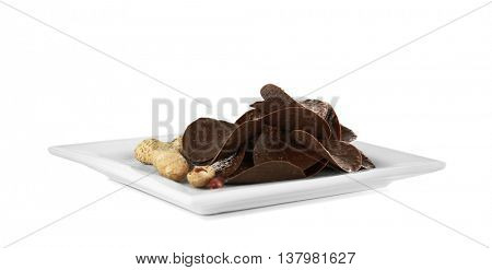Chocolate chips and peanut on white background