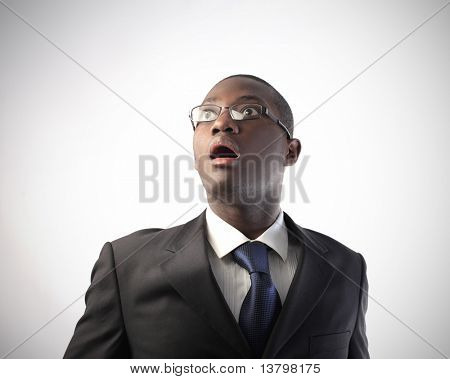 Astonished african businessman