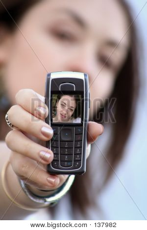 Beautiful Girl Showing Photo On Mobile Phone