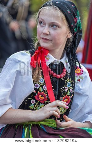 ROMANIA TIMISOARA - JULY 7 2016: Young girl from Poland in traditional costume present at the international folk festival