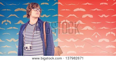 Thoughtful hipster looking away against composite image of mustaches