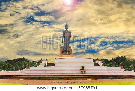 Buddha stood in a park on a beautiful sky