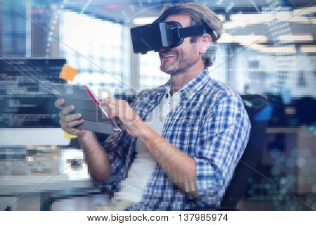 Composite image of face against happy businessman using virtual reality simulator