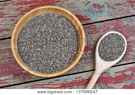Chia seeds in a bamboo bowl on table