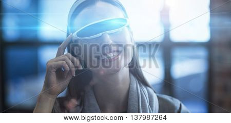 Smiling businesswoman using virtual reality headset in creative office