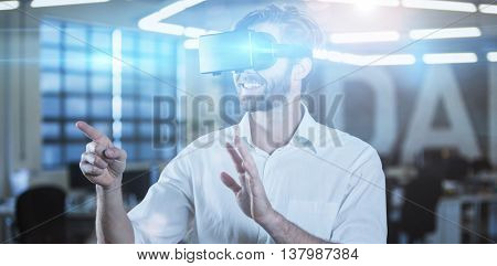 Smilling businessman gesturing while using virtual reality simulator in office