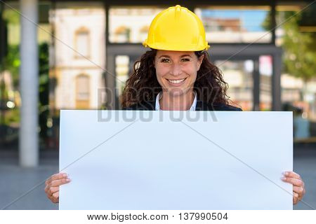 Smiling Young Architect Holding A Blank Sign