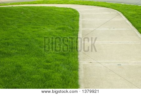 Pedestrian Walk Way With Grass On Side