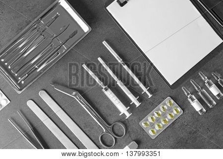 Medical tools set on dark gray background