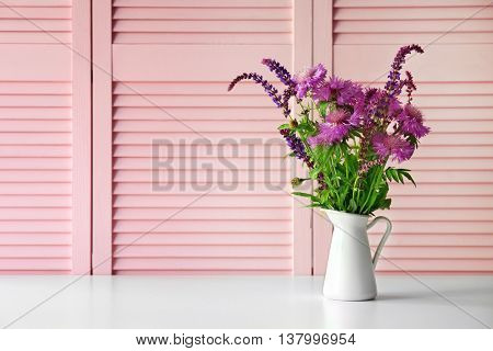 Wild flowers on pink folding screen background