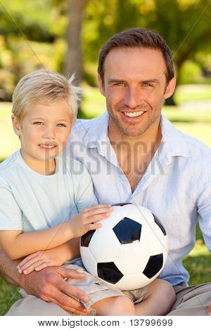 Father With His Son After A Football Game