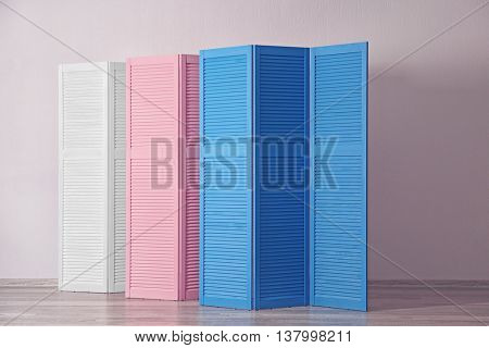 Color folding screens in room