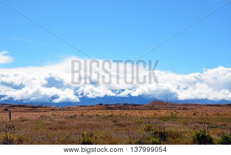 Clouds rolling over mountains and farmland in the New Zealand countryside