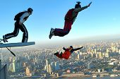 image of aerobatics  - BASE Jump off the top of the Jin Mao Tower in Shanghai China at sunrise - JPG
