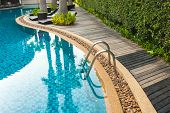 Постер, плакат: 25 May 2016 Hotel Swimming Pool With Sunny Reflections Swimming Pool Of Luxury Hotel Swimming Poo