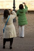 Tourists Taking Pictures With Point And Shoot Cameras poster
