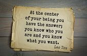Ancient chinese philosopher Lao Tzu quote on old paper background. At the center of your being you h poster