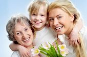 stock photo of granddaughters  - Portrait of happy girl hugging mature lady and woman - JPG