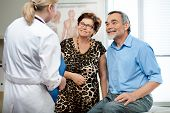 pic of elderly couple  - senior couple visiting a doctor at the doctor - JPG