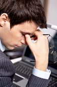 pic of fatigue  - Photo of fatigue man with his eyeglasses off keeping his hand near face after hard working day - JPG