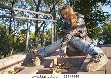 Teenage girl siting on the stairs
