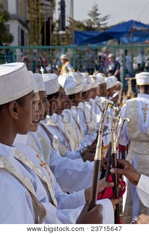 Christian Orthodox Devotees Standing In Line With Their Canes And Staffs At The Timket Festival.