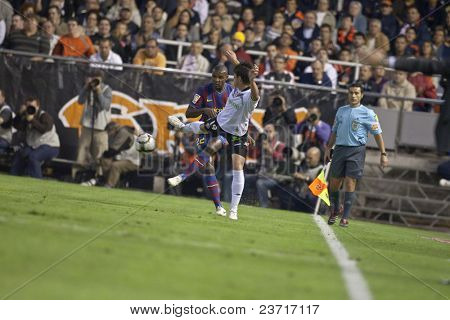 VALENCIA, SPAIN - OCTOBER 17 - Abidal - FootBall Match of Spanish Professional Soccer League between Valencia C.F. vs F.C. Barcelona - Mestalla Luis Casanova Stadium on October 17, 2009 in Valencia, Spain