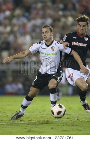 VALENCIA, SPAIN - OCTOBER 2 - Professional Soccer League between Valencia C.F. vs AT. Bilbao - Mestalla Stadium, Left Soldado, Aitor Ocio, Spain on OCTOBER 2, 2010
