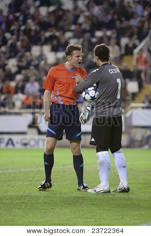 VALENCIA, SPAIN - NOVEMBER 2 - Left Referee Felix Brych and Cesar in the UEFA Champions league match between Valencia and Glasgow Rangers - Mestalla Stadium, Spain on November 2, 2010