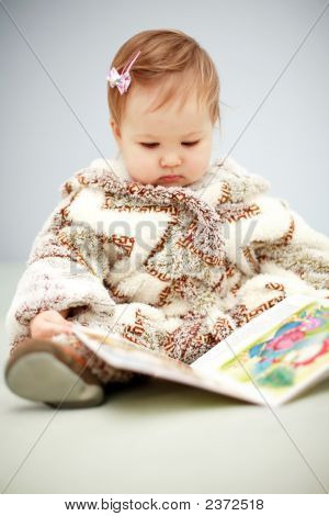 Small Baby Reading A Book