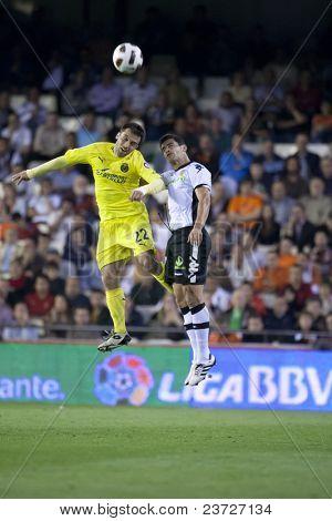 VALENCIA, SPAIN - APRIL 10 - #22 Rossi and Ricardo Costa in the Spanish Soccer League between Valencia c.f.. vs Villarreal c.f. - Mestalla Luis Casanova Stadium - Spain on April 10, 2011