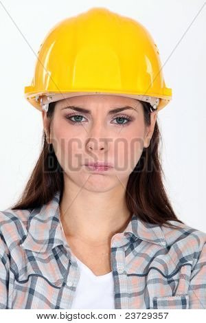 Angry construction worker making a face