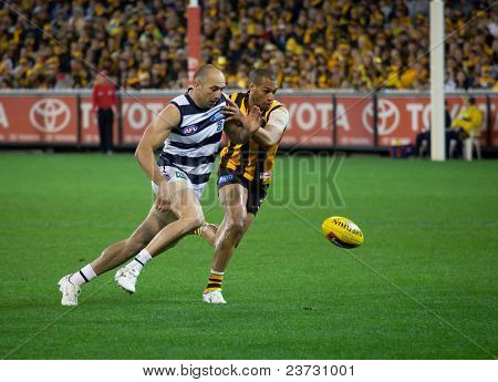 MELBOURNE - SEPTEMBER 9 : James Podsiadly (L) in action in Geelong's win over Hawthorn - September 9, 2011 in Melbourne, Australia.