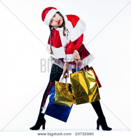 one woman dressed as santa claus carrying christmas bags tired on studio isolated white background