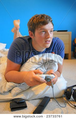 Young Adult Male Gaming at Home