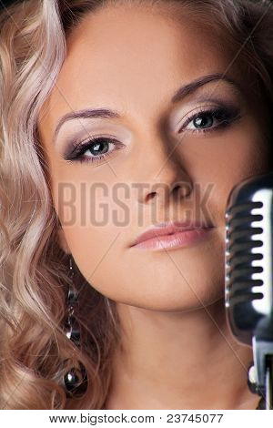 Beauty blond woman portrait with microphone