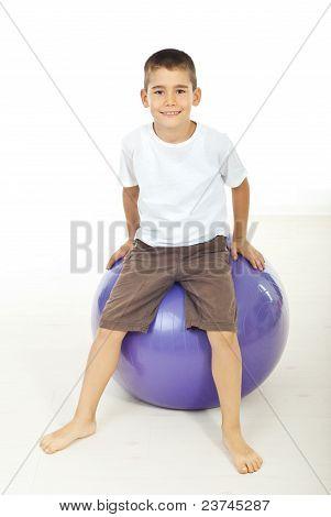 Boy Sitting On Pilates Ball
