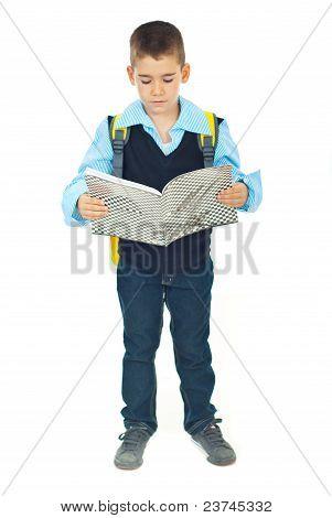 Full Length Of Schoolboy Reading