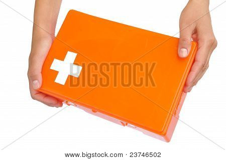 Hands of young woman holding first aid kit