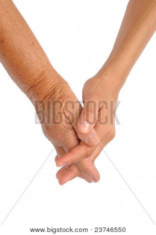 Manos de las mujeres jóvenes y mayores - concepto de mano de ayuda
