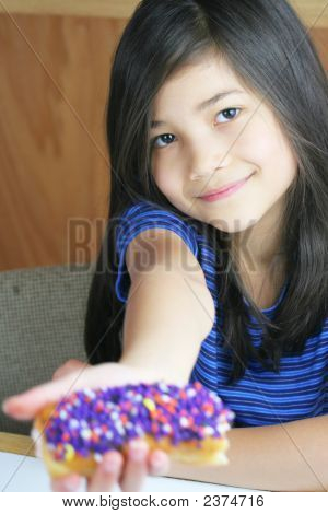 Girl Holding Colorful Donut, Ready To Eat