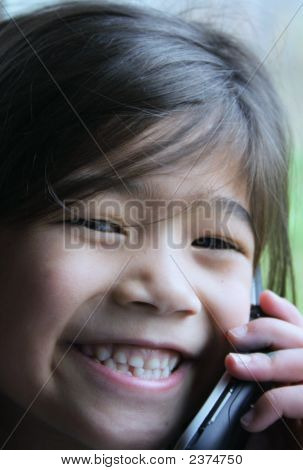 Six Year Old Girl Talking On Cell Phone.
