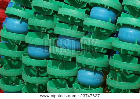 green plastic floaters